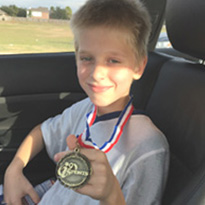 Camden Daniel with medal