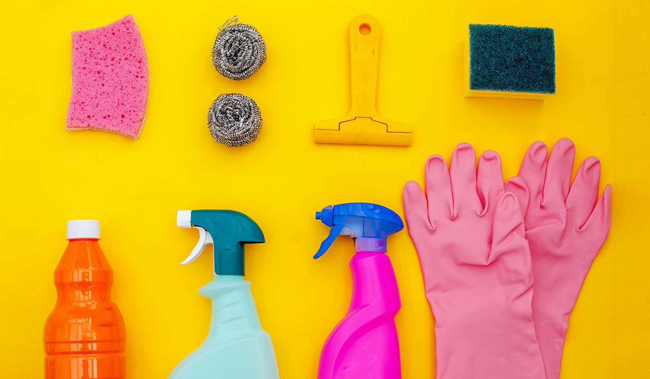 Pink rubber gloves and cleaning supplies