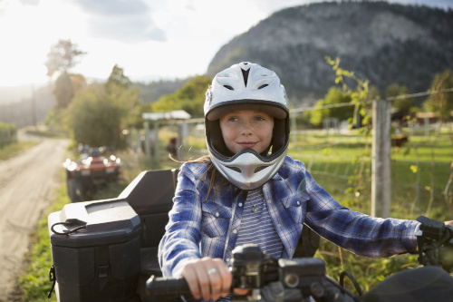 Child riding on an ATV