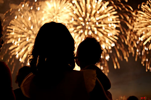 Mother and child watching fireworks