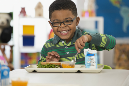 Child smiling and eating food