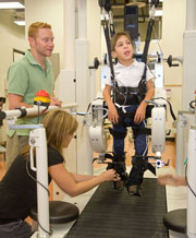 Child walking on rehabilitation machine