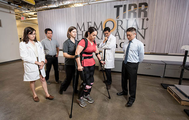 Patient walks with help of exoskeleton