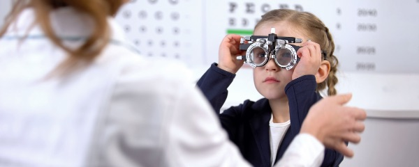 Doctor checking child's eyes